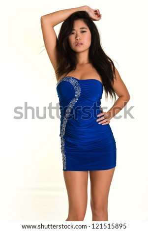 Pretty young Laotian woman in a strapless blue dress - stock photo