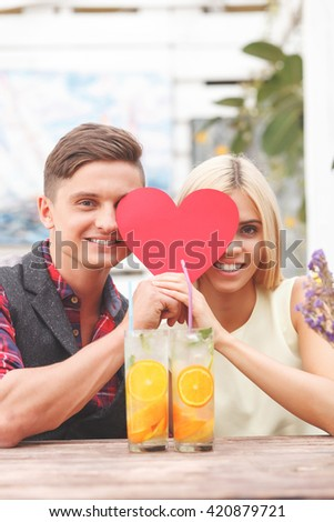 Pretty young lovers are resting in cafe - stock photo