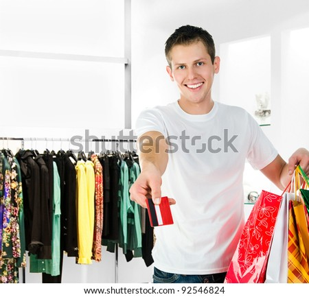 Pretty young men with packages is shopping - stock photo