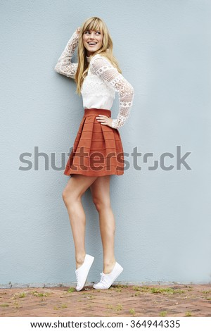 Pretty young model posing in fashionable clothes