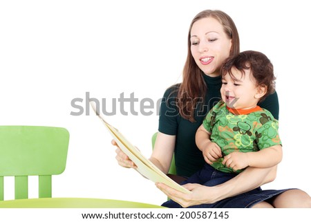 pretty young mother teaching her little child - stock photo