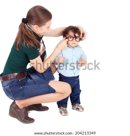 pretty young mother trying the glasses on her little child