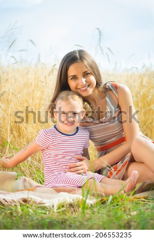 Pretty young mother with cute little daughter are happy in sunny day