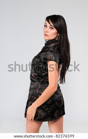 Pretty young multiracial woman in a Chinese dress