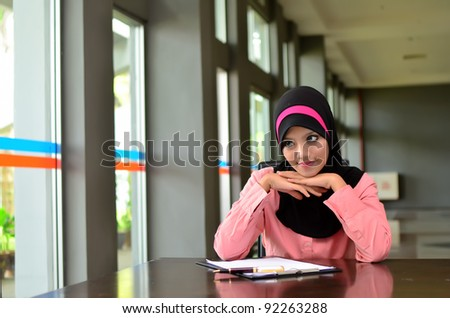Pretty young muslim study with lovely smile