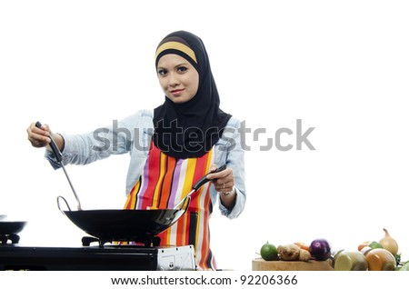 Pretty young Muslim woman are being cooking. - stock photo