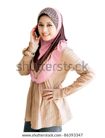 pretty young muslim woman with phone - stock photo