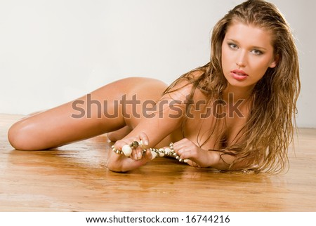 Pretty young naked woman portrait - stock photo