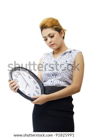 Pretty young office girl shown the clock in bad action over on white background. because late attendance.
