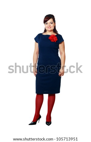 Pretty young plus sized lady in a dark blue dress - stock photo