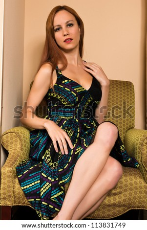 Pretty young redhead in a print dress - stock photo