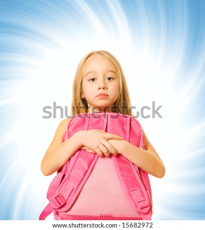 Pretty young school girl on abstract blue background - stock photo