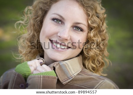 Pretty Young Smiling Woman Outdoor Portrait.