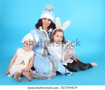 pretty young Snow Maiden with her cute little hares