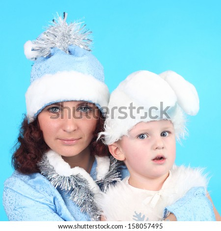 pretty young Snow Maiden with the cute little hare - stock photo