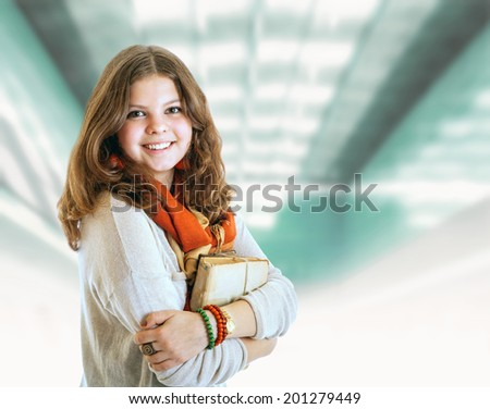 Pretty young student girl portrait with books - stock photo