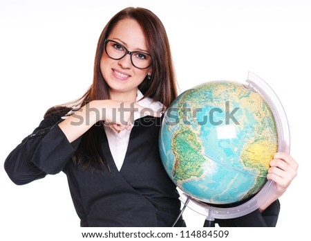 Pretty young teacher with globe over white background