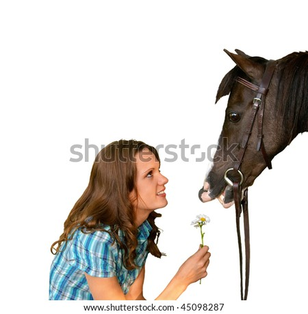 pretty young teenage girl giving a horse a flower - stock photo