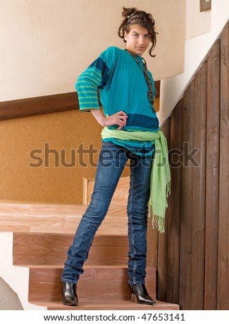 Pretty young teenager girl posing on stairs - stock photo