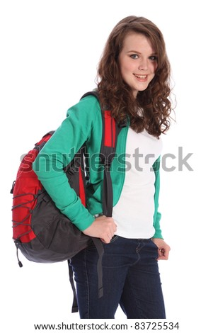 Pretty young teenager school girl, with long brown hair wearing green jumper and red school backpack with big happy smile. Studio shot against white background. - stock photo
