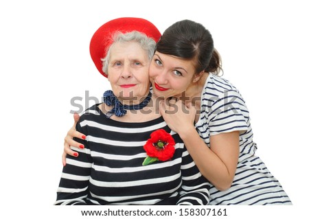 pretty young woman and grandmother together on white background - stock photo