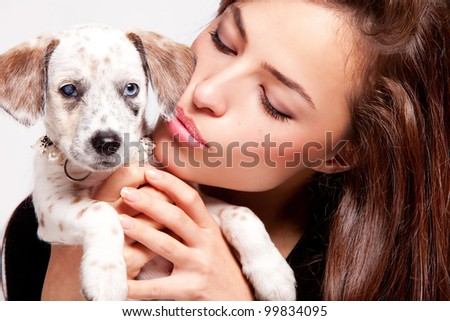 pretty young woman and puppy, close up portrait - stock photo
