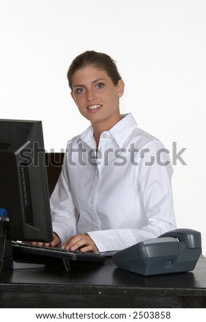 Pretty Young Woman at Desk with Computer and Phone