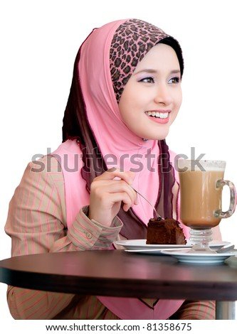 pretty young woman chatting at cafe - stock photo
