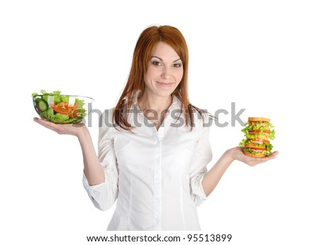 Pretty young woman choice lettuce salad or fast food. Isolated on the white background - stock photo