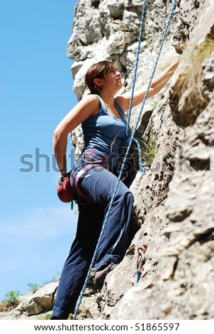pretty young woman climbing - stock photo