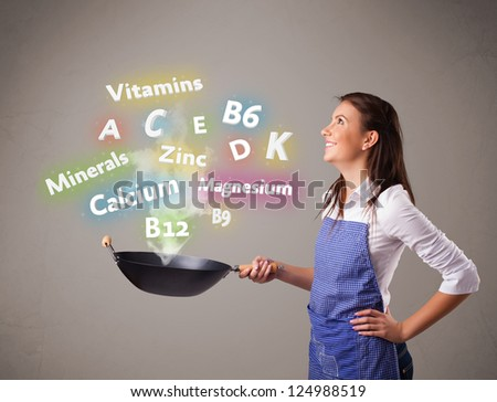 Pretty young woman cooking vitamins and minerals - stock photo