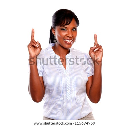 Pretty young woman crossing fingers while is looking at you on isolated background - stock photo