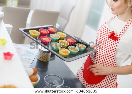 Woman Decorating Cupcakes beautiful cook showing stock images, royalty-free images & vectors