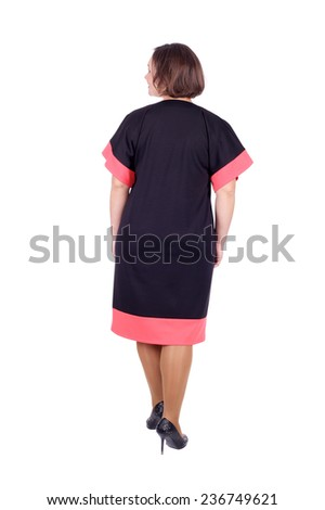 pretty young woman demonstrating a dress, back view - stock photo