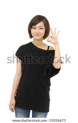 Pretty young woman doing the ok sign - stock photo