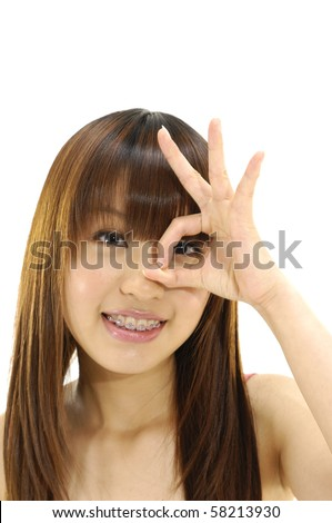 Pretty young woman doing the ok sign