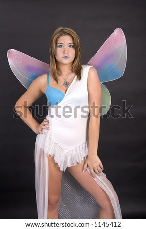 Pretty young woman dressed as fairy - stock photo