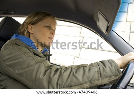 Pretty young woman driving a car