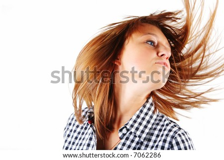 pretty young woman flinging long hair into air
