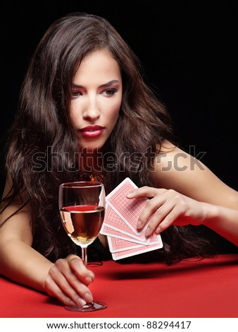 pretty young woman gambling on red table - stock photo