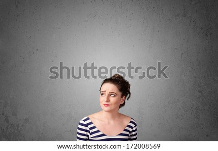 Pretty young woman gesturing with empty space