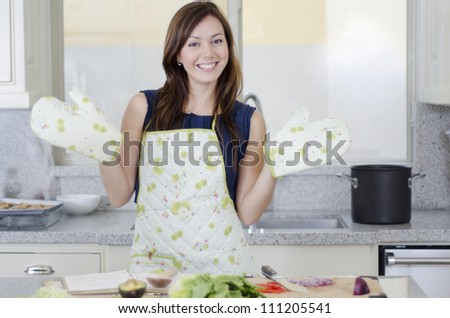 Pretty young woman having fun in the kitchen