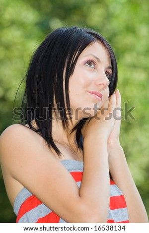 Pretty young woman having good time outdoors - stock photo