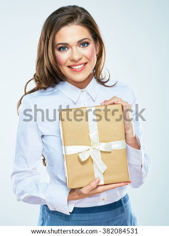 Pretty young woman hold paper gift box. White background isolated. Smiling female model with long curly hair. - stock photo