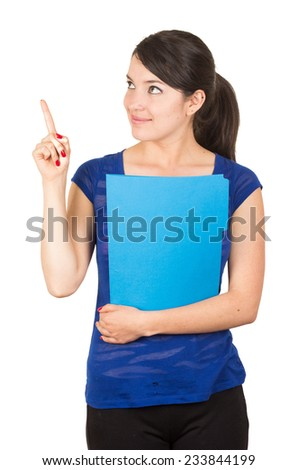 pretty young woman holding a blue folder pointing up isolated on white