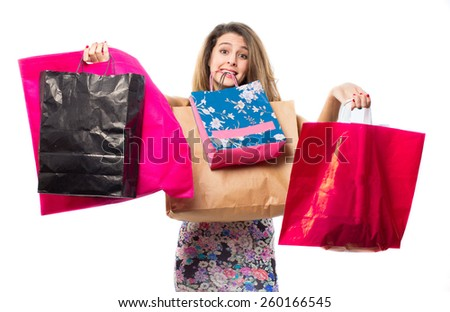 Pretty young woman holding a lot of shopping bags - stock photo