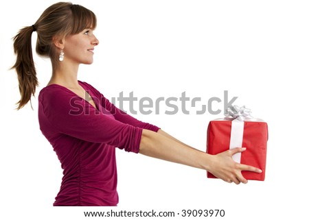 pretty young woman holding a present isolated on white - stock photo