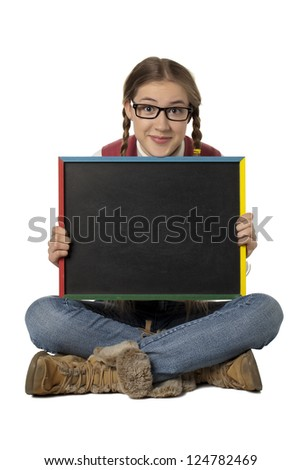 Pretty young woman holding an empty black board - stock photo