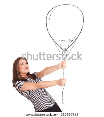 Pretty young woman holding balloon drawing - stock photo