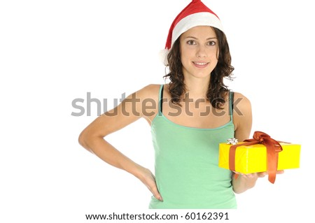 Pretty young woman holding christmas gift - stock photo